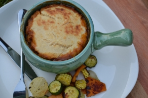Meat pies with butter bean pie topping and roasted veggies.