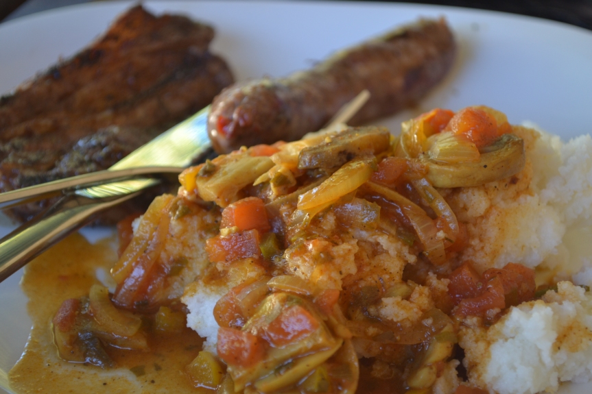 Braai - Chops and Maize meal with a tomato, onion and mushroom relish.